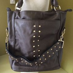 """crazy cool CHARMING CHARLIE BAG-⬇️price Brown faux leather with gold studs.                     Pockets galore • front, back inside. Bag is 15"""" high-16"""" wide -7"""" bottom width. 2 handle strap 18 1/2"""". Gently used • NO TRADES Charming Charlie Bags"""