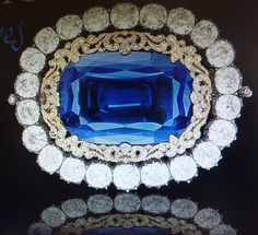 This Russian Sapphire & Diamond brooch, once belonged to the Russian Imperial family sold at Christies in Switzerland in 2011 & appears to be the counterpart to the Queen`s slightly smaller, round brooch as they have the same setting & design.   They were a wedding present to Princess Marie of Hesse when she became the bride of the future Tsar Alexander II in 1841. This one could be  the clasp on a pearl necklace (or fit in to a tiara) & the Queen`s, the clasp on a pearl bracelet.