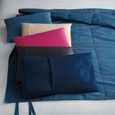 2-in-1 Down Free Travel Pillow & Throw - Featured on The Talk, two great travel accessories in one. A travel pillow unfolds to a perfectly sized throw blanket.