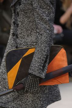 Burberry Prorsum Fall 2012 - love the graphic bag with tweed coat