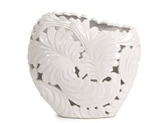Enrich your room's natural beauty with this Ortiz medium cutwork leaf vase.