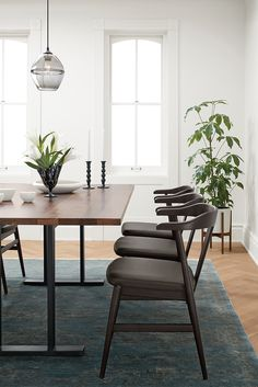 Evan's smooth, sculptural form comfortably cradles your back as you enjoy a meal, while shorter arms allow you to neatly tuck it underneath a dining table.