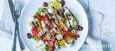 Deze salade met gebakken champignons, geitenkaas en balsamico is een heerlijke lunch of bijgerecht