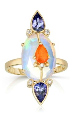 A beautiful opal ring by Loriann Jewelry. With sapphire, tanzanite, and diamond accents. #beautifulfinejewelry