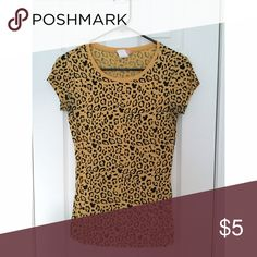 Funky leopard tee Excellent condition. Worn only a few times. Pair with black skinnies and some Vans slip ons for a cool, casual vibe 😎 Tops Tees - Short Sleeve