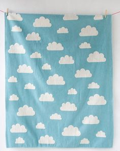 The Finn cloud blanket from David Fussenegger textiles offers parents a high quality blanket that will last for years in a design which will take your baby through childhood.  Finn cloud is a double sided blanket - one side is blue with white clouds, the other is white with blue clouds. The blanket is beautiful to the touch with bound edges, and is cotbed size so will last for years.   Features:   * Double sided offering a choice of main colour of blue or white with contrasting cloud design…