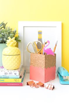Make a DIY scalloped cork pencil cup for organizing office supplies on your desk in a simple cup made from cork board and painted your fav color!