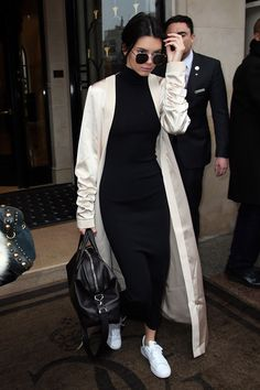 Kendall Jenner in Paris wearing a floor-length satin robe coat, black turtleneck dress and white sneakers.