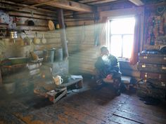 One of the warmest places on earth, is the Siberian log cabin out in the wilderness. A fire is almost always going, food is always served and the wood stove is the center of life.  This photo was taken at a permenent residence of a couple at Chirpolay, a reindeer community in the Chabarovsk Krai, a few days travel north by reindeer from Arkah.