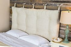 Here's a rustic-chic idea for your bedroom: create a cushion to use as a headboard!