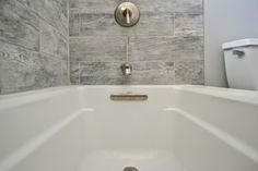 Fiberglass Tub With Tile Surround And Shampoo Niches