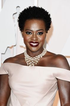 Viola showed off her natural hair, superlong lashes, and a glossy cabernet lip.