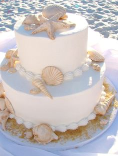 Beach Wedding Cake, beige tinted edible shells with brown sugar as sand...our most popular choice amoungst beach brides