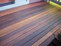 LOVE this multistained deck...I've thought of two tone staining the deck vs the rails..but this is way cool!