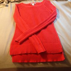 Coral long sleeve sweater Medium size long sleeve sweater. In good condition! See through, so need a tank underneath. Fits a small and medium best. Tops Sweatshirts & Hoodies