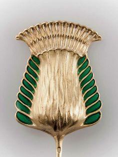 RENE LALIQUE |  'Fleur de chardon' hatpin, c1900. 3 x 2.2 cm. Gold, green plique-à-jour enamel.