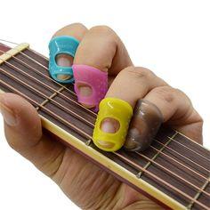 4 in 1 Fingertip Protector Fingerstall Silicone Guitar String Finger Guard Left Hand Against the Press Sore Finger Ballad Guitar #Affiliate