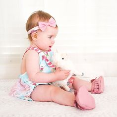 baby with adorable pink Phonak SkyQ hearingaids