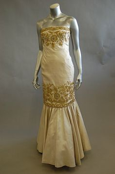 A Victor Edelstein ivory wild silk and gold embroidered ball gown, 1980s