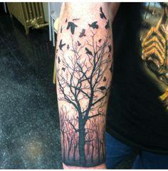 Creepy tree tattoo