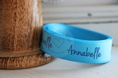 Personalised ribbon using our midnight blue foil on turquoise satin ribbon