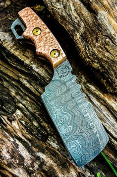 Half Life Knives damascus cleaver with hammered copper scales... Feel free to check us out Facebook at Half Life Knives