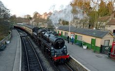 A British Railways Standard Class 76079 arrives at Pickering Station on the North Yorkshire Moors Railway, as part of events marking the 50th Anniversary of the closure of the line following the Beeching report. On 8 March 1965 the railway route between Grosmont and Rillington, near Malton, was closed by British Railways under the infamous 'Beeching Axe'. The NYMR is marking the 50th anniversary of this monumental event with a weekend of traction that reflects what would have been seen when…