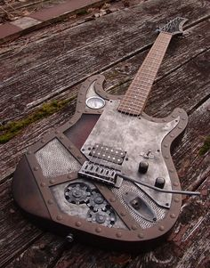 "Steampunk ""Fender style"" custom guitar. Weathered copper color paint on body & headstock. Rosewood fretboard, has 7 LED lights wired in, that can be turned on by the toggle switch on the pickguard. Two AA batteries run the LEDs stored under the pickguard."