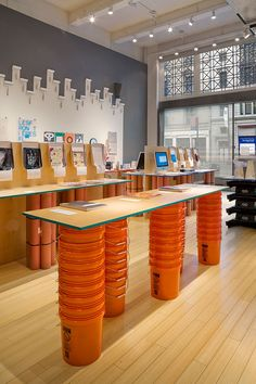 AIGA Annual Design Exhibitions Using everyday objects. Stacked buckets for table legs - so smart!