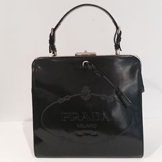 % AUTHENTIC NWT PRADA LEATHER LOGO EMBOSSED BAG % AUTHENTIC - NWT.  VINTAGE ITEM. PURCHASED AT NEIMAN MARCUS. AUTHENTICITY CARD & DUST COVER INCLUDED. Prada Bags Satchels