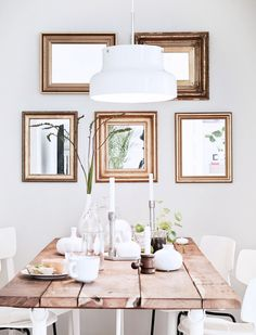 Inside a Chic Small Home With Major Style | DomaineHome.com // Calming dinning space with gold mirror arrangement.