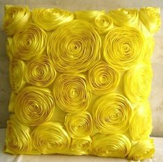 Yellow pillow will add some sunshine to a room:-)