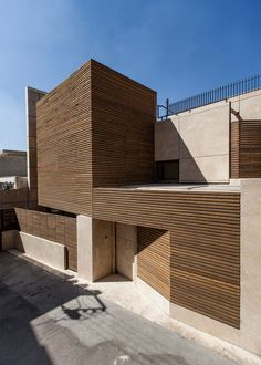 love the angles leading to front door - Bagh-Janat residential architecture with timber and travertine cladding in Isfahan Iran by Bracket Design Studio Wood Architecture, Residential Architecture, Contemporary Architecture, Architecture Details, Design Loft, Design Studio, Design Exterior, Facade Design, Wooden Facade