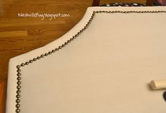 Drop Cloth Headboard with Nailhead Trim- How to Apply a Nailhead Trim to anything- Super easy & Super inexpensive.