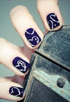 I like these navy blue nails with white hearts on it, so cute!