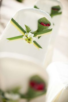 Green and white thai orchid chair decoration. Beach wedding ceremony, Koh Samui, Thailand