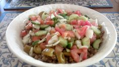 Majadara with Arabic Salad and pickled hot peppers.