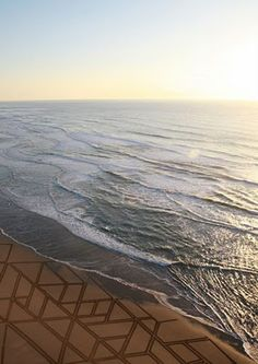 Artist- Jim Denevan Medium- Nature Art / Photography Meaning of the Art- To create a design imprinted onto the sand of a beach