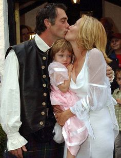 Emma Thompson with her second husband, Greg Wise on their wedding day in 2003. The little girl is their daughter, Gaia.