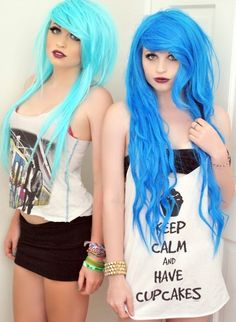 I love their hair colors sooo much!!!!!!!!!! :D And the one on the right... Her hair is SO LONG!!! That is my goal, but I'm still between a pixie and a very short bob :/