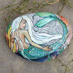 Another mermaid swam from my brush.....