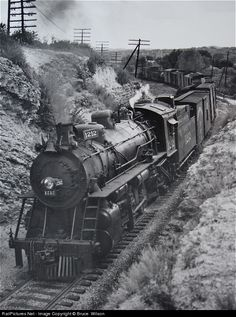 Northbound Mikado No.1212, built by Alco in 1911, works uphill in the cut north of Sixth Street., photo 1947, so that engine had been workin hard for 36 years, and probably went well into the 50's