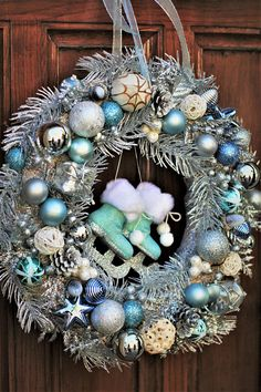 Christmas Wreath, Silver Wreath, Christmas Decor, Door Wreath, Door Decor, Silver Blue Wreath A beautiful, unique silver door wreath for Christmas! Made with Christmas balls and other decorations of different shades of blue and silver colors. This wreath measures approximately 13
