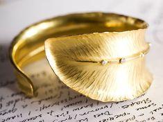 Feather Wrap Cuff Bracelet by Alexandra Hart - 18k gold fold and hammer formed cuff bracelet with bezel set diamonds www.alexandrahart.com/