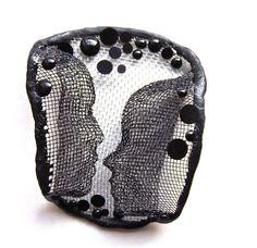 """Alina Carp - brooch   """"Inamorato"""", made of steel mesh, resin and silver."""