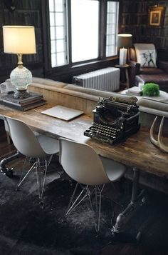 Such cool mix of antique-, contemporary and vintage style with eames chairs, classic typewriter and elegant furniture