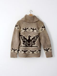 A vintage hand-knit cowichan sweater. The thick wool sweater features a thunderbird eagle pattern in natural wool tones and a zipper closure. - cowichan sweater - zip up closure cardigan - thick wool Cowichan Sweater, Fair Isle Knitting Patterns, Icelandic Sweaters, Sweater Making, Cool Sweaters, Knit Jacket, Sweater Coats, Knitwear, Knit Crochet