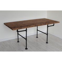 This wood and iron pipe 6 foot dining table brings families and loved ones together with its spacious top and large 6 foot size. Each table is hand made in Portland using only the best Oregon grown Douglas fir. True American creativity and craftsmanship is highlighted in the unique iron piping leg design. This rustic table is stained in beautiful shades of natural wood colors, hand finished with a clear coat that protects and preserves the table from water marks or stains.