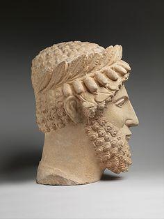 Limestone head of a bearded man wearing a wreath  Period:     Classical Date:     early 5th century B.C. Culture:     Cypriot Medium:     Limestone