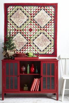 Classic Christmas Quilt - Use a variety of traditional holiday colors and prints in a wall hanging fit for decking the halls. Metallic touches and star and snowflake quilting make this a Christmas favorite. Fabrics are from the Wrapped in Joy collection by Rachel Thomas Pellman for Marcus Fabrics. Quilting designs courtesy of Handi Quilter.